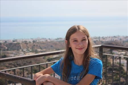 My daughter and the view from the Mirador del Castillo, the highest point of Mojacar.