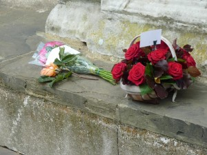 The basket of roses and other flowers waiting outside the chapel to be laid on Anne's tile. c. Paudie Kennelly