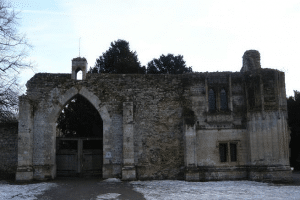 Ramsey Abbey, carved gatehouse with ornate oriel window, 15th century.